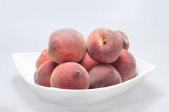 Peaches on plate Royalty Free Stock Photography