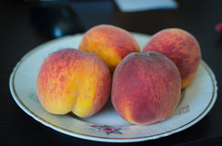 Peaches on a plate Stock Photo
