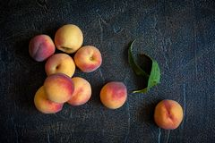 Peaches. On plate on a vintage background Royalty Free Stock Images