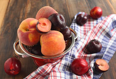 Peaches and plums. On the table Royalty Free Stock Photos