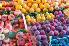 Peaches and plums for sale Stock Images