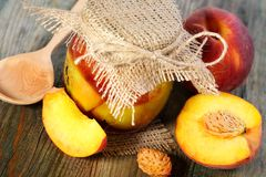 Peaches and pot of jam close up. Royalty Free Stock Photography