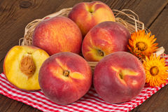 Peaches on red checkered tablecloth Stock Photography
