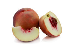 Peaches. Ripe fresh peaches with half and slice isolated on whit Royalty Free Stock Photo