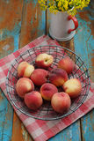 Peaches. On a rustic table Stock Photography