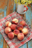 Peaches. On a rustic table Royalty Free Stock Photo