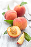 Peaches on rustic table. Royalty Free Stock Image