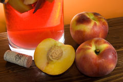 Peaches And Sangria. Food And Drinks - Peaches and sangria on wood table Royalty Free Stock Image