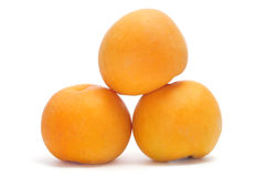 Peaches. Some yellow peaches on a white background Royalty Free Stock Images