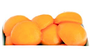 Peaches in syrup. Isolated on white background Royalty Free Stock Images