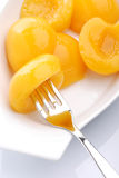 Peaches in syrup Stock Image