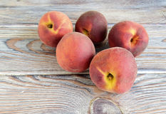 Peaches. Are on a table. Fruit are fresh, juicy, mature Stock Photos