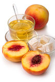 Peaches and tea with delight Royalty Free Stock Image