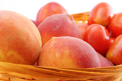 Peaches and tomatoes close-up Royalty Free Stock Image