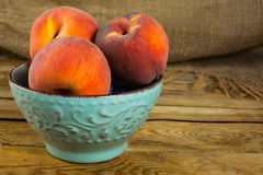 Peaches in the turquoise cup Stock Images