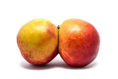 Peaches twins isolated on white Royalty Free Stock Photos
