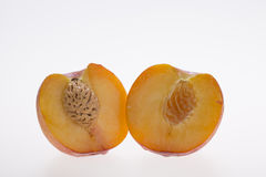 Peaches. Two half juicy peaches with white background Stock Photo
