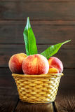 Peaches in weaved basket Royalty Free Stock Photo