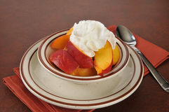 Peaches and whipped cream Royalty Free Stock Images
