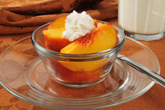 Peaches and whipped cream Stock Photos