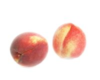 Peaches on white. Two peaches  close-up on white isolated Royalty Free Stock Photo