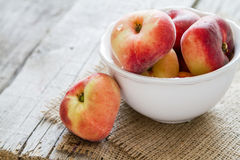 Peaches in white bowl Stock Images