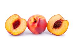 Peaches whole and cutted in halves on a white background isolated close up stock images