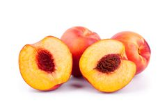 Peaches whole and cutted in halves on a white background isolated close up royalty free stock images