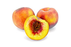 Peaches whole and half Royalty Free Stock Photo