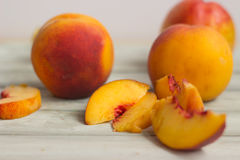 Peaches, whole and slices royalty free stock photography