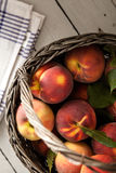 Peaches in a Wicker Basket Stock Images