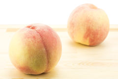 Peaches on wood board Stock Photography