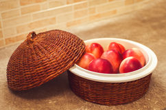 Peaches in  a wood container. Some peaches in a wood container Royalty Free Stock Images