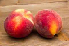 Peaches on wood Stock Photo