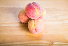 Peaches on Wood Table Royalty Free Stock Photos