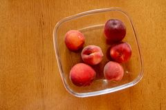 Peaches on a wood table Stock Photo