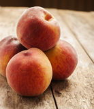 Peaches in wooden background Royalty Free Stock Photography