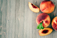 Peaches. On wooden background with copy space Stock Images