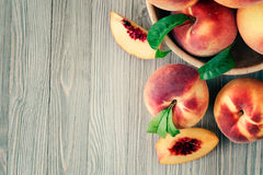 Peaches. On wooden background with copy space Royalty Free Stock Photos