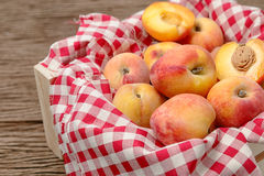 Peaches on wooden background Stock Image