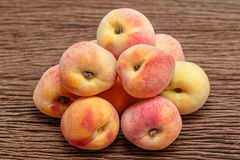 peaches on wooden background Royalty Free Stock Photos