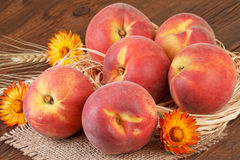 Peaches on wooden background Royalty Free Stock Photography