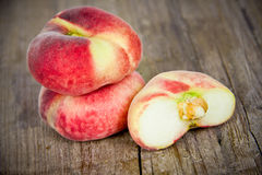 Peaches on wooden board Royalty Free Stock Image