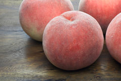 Peaches on the wooden board Royalty Free Stock Photography