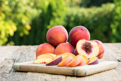 Peaches. On a wooden table Royalty Free Stock Photo