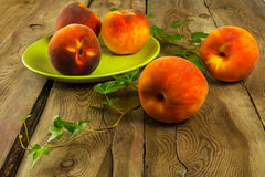 Peaches on a wooden table Royalty Free Stock Photography