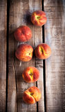 Peaches on wooden table. Peaches group on rustic wooden table Stock Image