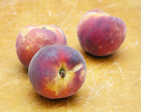 Peaches on wooden textured Stock Images