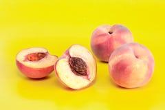 Peaches On Yellow Stock Photo