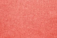 Peachy orange shade fabric textile texture of Pantone's color. Peachy orange or bright coral shade fabric textile texture of Pantone's color of the royalty free stock photography